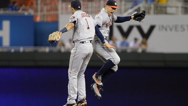 Houston Astros right fielder George Springer (4) celebrates with shortstop Carlos Correa (1) after Friday's game against Kansas CIty at Kauffman Stadium. The Astros won 13-4.