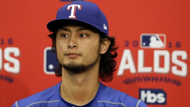 Texas Rangers pitcher Yu Darvish, of Japan, listens to a question during a news conference before Game 1 of the American League Division Series baseball game against the Toronto Blue Jays, Thursday, Oct. 6, 2016, in Arlington, Texas. Darkish is expected to pitch in Game 2. (AP Photo/LM Otero)