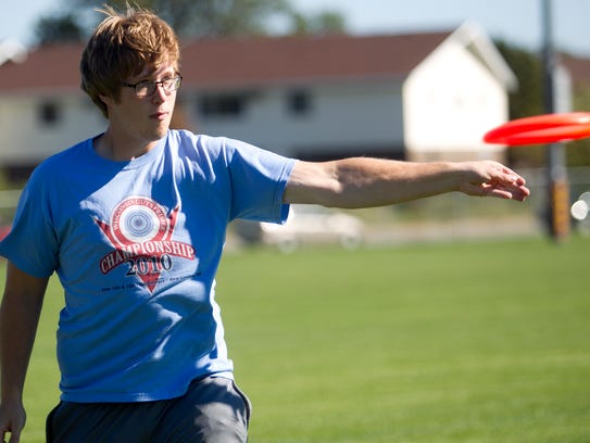 UWSP student Josh Tews, 19, throws the frisbee to the
