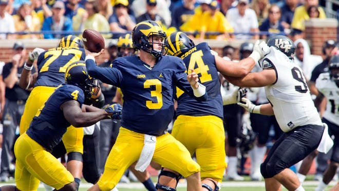 Michigan quarterback Wilton Speight (3) throws a pass in the third quarter of an NCAA college football game against Central Florida at Michigan Stadium in Ann Arbor, Mich., Sept. 10, 2016. Michigan won 51-14.