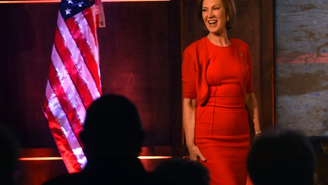Republican candidate for President Carly Fiorina takes the stage during an event organized by American for Prosperity at the Atlantis Hotel & Casino in Reno on Dec. 16, 2015.