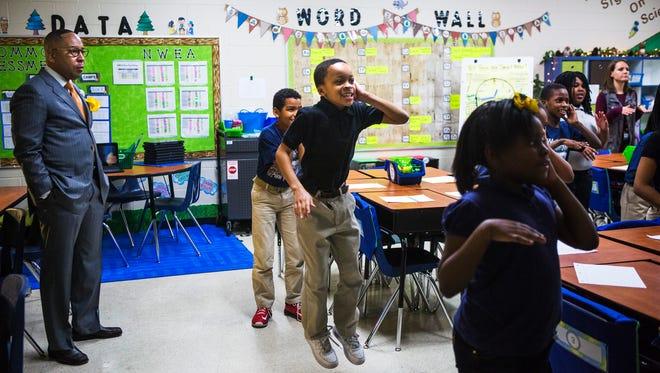 Westhaven Elementary principal Rodney Rowen observes the scene in Amber Todd's third grade math class on Jan. 13, 2017, as Tyjuan Horton (center), 8, dances along to a video with his classmates on Friday. Westhaven Elementary is a new school in the iZone. Under the new law, local school districts will have the first opportunity to turn around struggling schools before the state considers a takeover.