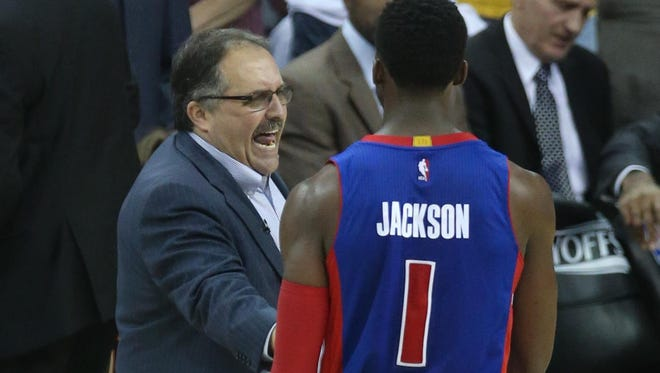 Pistons coach Stan Van Gundy talks with Reggie Jackson on Sunday. Jackson was hit with a technical foul with 3:24 remaining.
