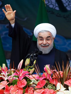 Iranian President Hassan Rowhani waves to the crowd on Feb. 11, 2015, during a ceremony in Tehran marking the 36th anniversary of Iran's 1979  revolution.