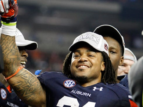Auburn Tigers running back Tre Mason (21) is awarded the MVP in the 2013 SEC Championship game against the Missouri Tigers at Georgia Dome. Auburn won 59-42.