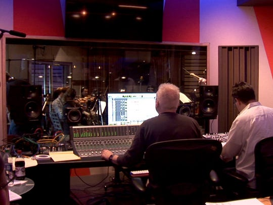 Musicians practice the CBS Elections Theme song.