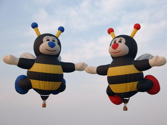 The attractions include a family of 110-foot-tall bumblebees,