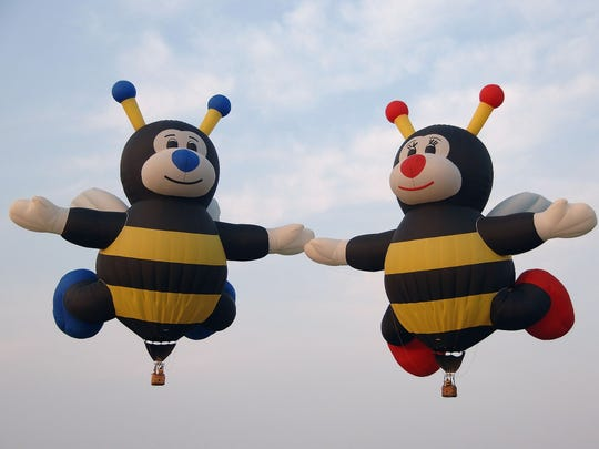 The attractions include a family of 110-foot-tall bumblebees, a five-story-tall American flag and an 807-pound balloon shaped like an anniversary cake.
