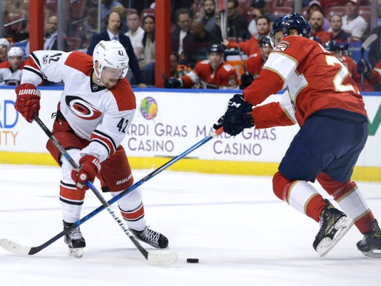 Carolina Hurricanes' Joakim Nordstrom (42) and Florida Panthers' Nick Bjugstad go for the puck during the first period of an NHL hockey game, Tuesday, Feb. 28, 2017, in Sunrise, Fla. (AP Photo/Lynne Sladky)