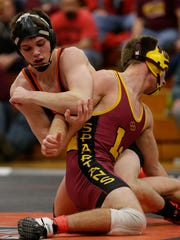Oconto Falls junior Nate Trepanier stays in control of Luxemburg-Casco's Jacob Zellner during their 152-pound match during a Bay Conference wrestling dual at Oconto Falls on Jan. 21. Trepanier is 32-0 this season.