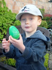 Damien Turk, 3, of Gig Harbor, helps to open his eggs