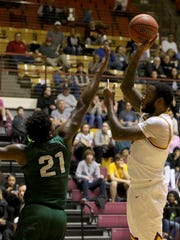 Midwestern State's Josh Huntley puts in the short jumper