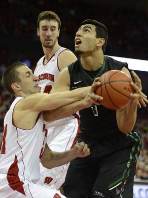 UW-Green Bay's Kerem Kanter (1) is fouled by Wisconsin's  Josh Gasser (21) while driving to the basket in the second half during Wednesday night's game at the Kohl Center in Madison.