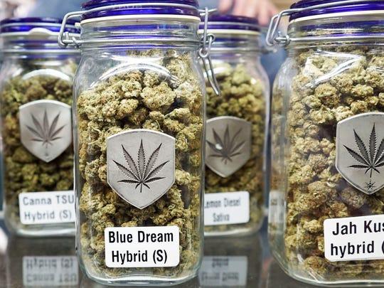 Jars of medical marijuana sit on a shelf inside a Denver-based marijuana dispensary