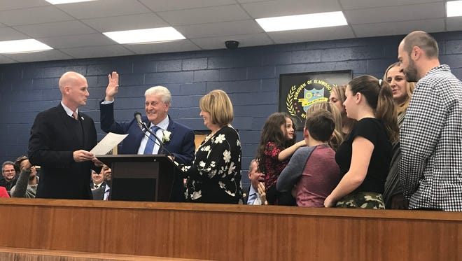 Frank Caramagna, joined by his family, is officially sworn-in as mayor of Elmwood Park Nov. 17, 2017.