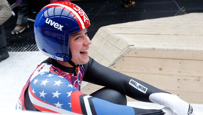 ; Kate Hansen (USA) reacts after her fourth run in women's single luge during the Sochi 2014 Olympic Winter Games at Sanki Sliding Center on Feb. 11.