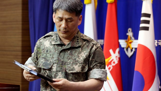 South Korean Army Col. Eom Hyo-sik leaves after giving a briefing on a North Korean navy ship which fired two artillery shells in the Yellow Sea, at the Defense Ministry in Seoul, South Korea, on May 22, 2014.