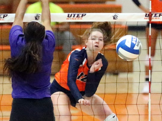 UTEP's Macey Austin, 12, hits a shot against Western New Mexico during their exhibition match in August 2017 in Memorial Gym.