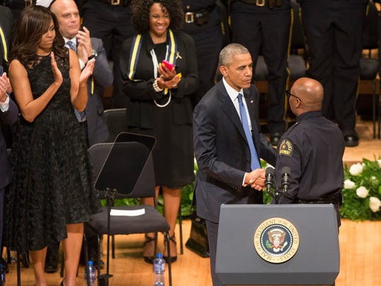 President Obama, left, shaking hands with Dallas Police