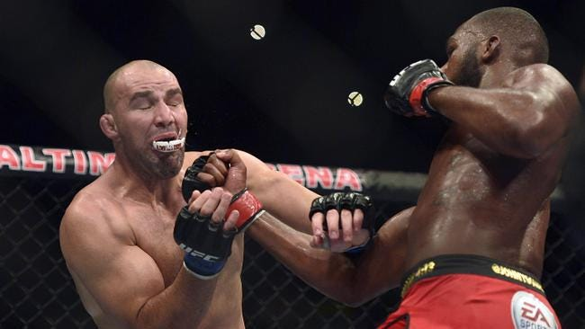 Jon Jones hits Glover Teixeira with an upper cut during the UFC light heavy weight championship fight at Baltimore Arena. Jones retained the light heavy height championship by defeating Teixeria.