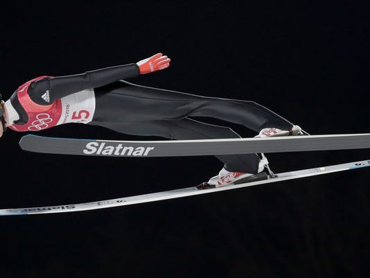 Robert Johansson, of Norway, soars through the air during men's large hill Individual ski jumping competition at the 2018 Winter Olympics in Pyeongchang, South Korea, Saturday, Feb. 17, 2018. (AP Photo/Dmitri Lovetsky)