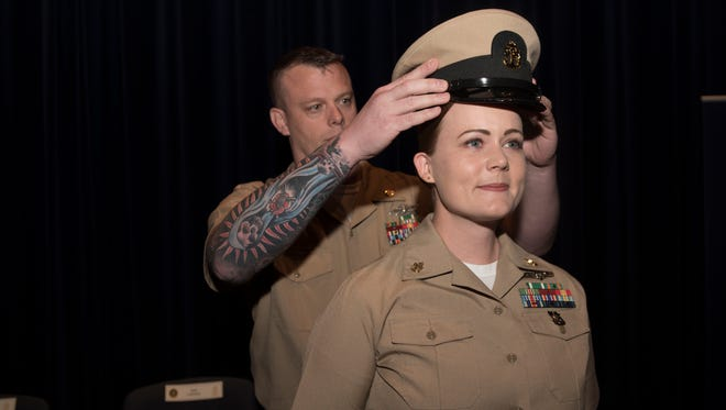 WASHINGTON (May 17, 2018) - The Fiscal Year 2017 U.S. Navy Shore Sailor of the Year Chief Legalman Jean Yusten, assigned to U.S. Naval Forces Europe-Africa / U.S. 6th Fleet, receives her combination cover after being meritoriously advanced to the rank of chief petty officer during the annual Sailor of the Year ceremony at the U.S. Navy Memorial in Washington. Yusten is one of four Navy Sailors of the year (SOYs). Throughout their weeklong visit to Washington, the SOYs and their families toured historic sites and enjoyed special events held in their honor. (U.S. Navy photo by Mass Communication Specialist 2nd Class Huey D. Younger Jr./Released)