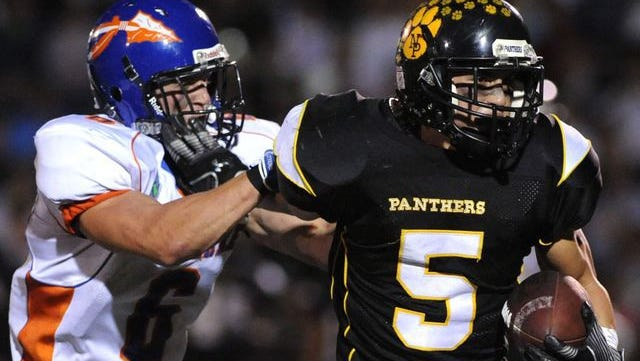 Newbury Park: Westlake´s Michael Tack gets a shove-off by Newbury Park´s Phillip Muscarella carrying the ball in the first half against Newbury Park.