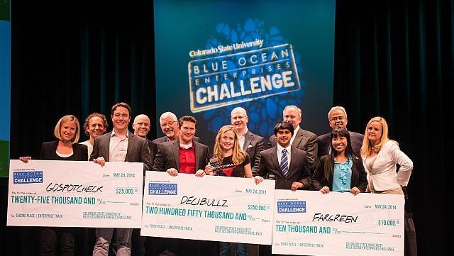 Winners of the inaugural Blue Ocean Enterprises Challenge, on stage at the Lincoln Center, with sponsors from Galvanize, Blue Ocean Enterprises, OtterBox, HP, and the Colorado State University College of Business. Photo by Patrick Edmiston.