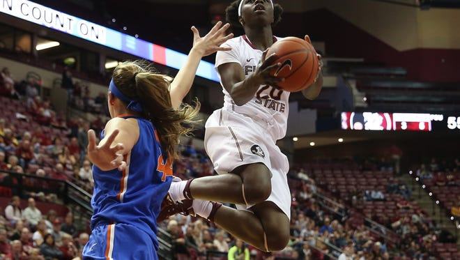 FSU's Shakayla Thomas tries to lay the ball up past Florida's Haley Lorenzen during their game at the Tucker Center Thursday.