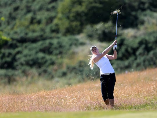 Sweden's Louise Larsson plays a shot from the rough on the 9th fairway during the second day of the Women's British Open golf championship on the Royal Birkdale Golf Club, Southport, England, Friday, July 11, 2014. (AP Photo/Scott Heppell)