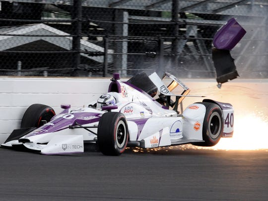 AJ Foyt Racing IndyCar driver Zach Veach (40) hits the wall coming out of turn one during practice for the Indianapolis 500 Friday, May 19, 2017, afternoon at the Indianapolis Motor Speedway.