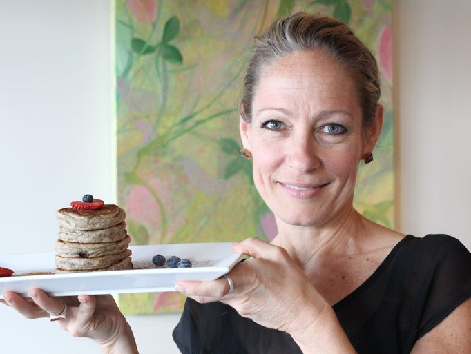 Tulip Noir owner Dina Romay-Sipe holds her Gluten free