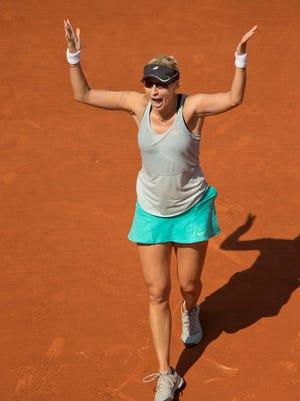Mirjana Lucic-Baroni of Croatia celebrates her victory Wednesday atainst No. 3 seed Simona Halep of Romania.