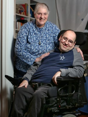 Carol Barnett and her brother Steve, at the home they share in Newport. Carol was recently honored as a caregiver for Steve, who has cerebral palsy.