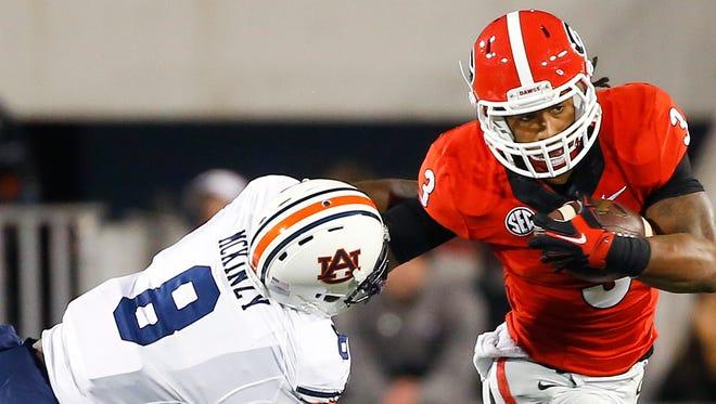 Georgia running back Todd Gurley tries to get past Auburn linebacker Cassanova McKinzy on Saturday.