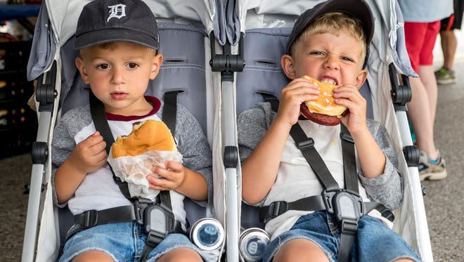 Charlie Allen, 2, left, and his brother Max, 4, eat bologna sandwiches at the Yale Bologna Festival July 28.