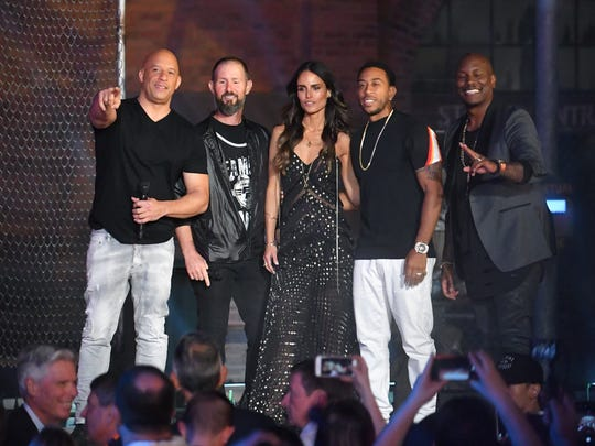 Fast & Furious-Supercharged has opened at Universal Orlando. The May 2nd opening celebration included cast members of the film franchise. Photo shows Vin Diesel, Scotty B., who was the emcee of the for the event, Jordana Brewster, Ludacris, and Tyrese Gibson.