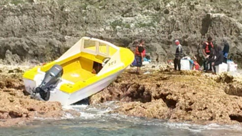 An image of the grounded vessel on Rota.