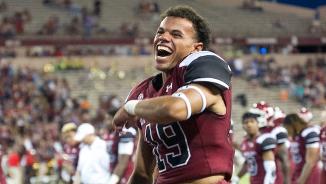 NMSU freshman Isaiah McIntyre and the Aggies beat rival New Mexico 32-32 on Saturday.