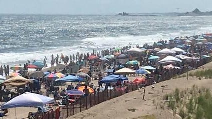 Misquamicut State Beach in Westerly was jam-packed at high tide on Sunday afternoon.