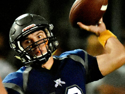 Dallastown's Cade Gold looks to throw the ball during Friday night football action against Spring Grove in Dallastown, Pa. on Friday, Sept. 25, 2015. Dallastown would win the game 20-10. Dawn J. Sagert - dsagert@yorkdispatch.com