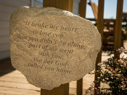 Bill Carter has a stone on his back deck in memory of his wife Shirley in rural Lacona, Iowa, Thursday June 16, 2016. Shirley was murdered at their home a year ago June 19. There have been no arrests yet in the case.
