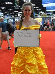 """Madeline Thomas dresses up as Belle from """"Beauty and the Beast"""" at Gen Con 2016."""