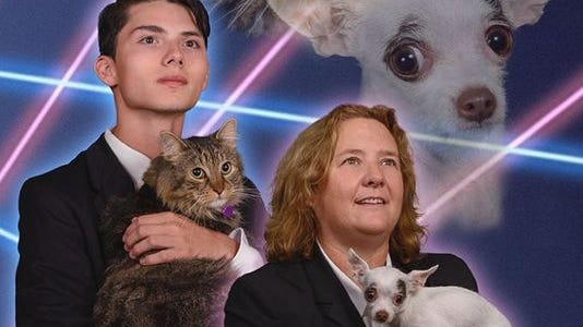 Draven Rodriguez stands with his principal and their pets in a yearbook image.