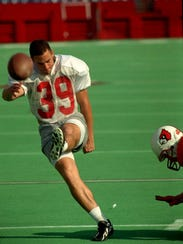 David Akers kicks for Louisville in 1996.