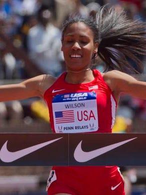 Ajee Wilson, former Neptune High School graduate ran the anchor leg of USA vs World  Women's Sprint Medley Relay taking first on Saturday at Penn Relays in Philadelphia Pa on April 26, 2014.