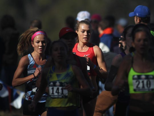 FSU alum Colleen Quigley, who is now a pro runner for Bowerman Track Club in Portland, Ore., did the Tomahawk Chop on her way to a win in Saturday's USA Track & Field National Club Cross Country Championship at Apalachee Regional Park.