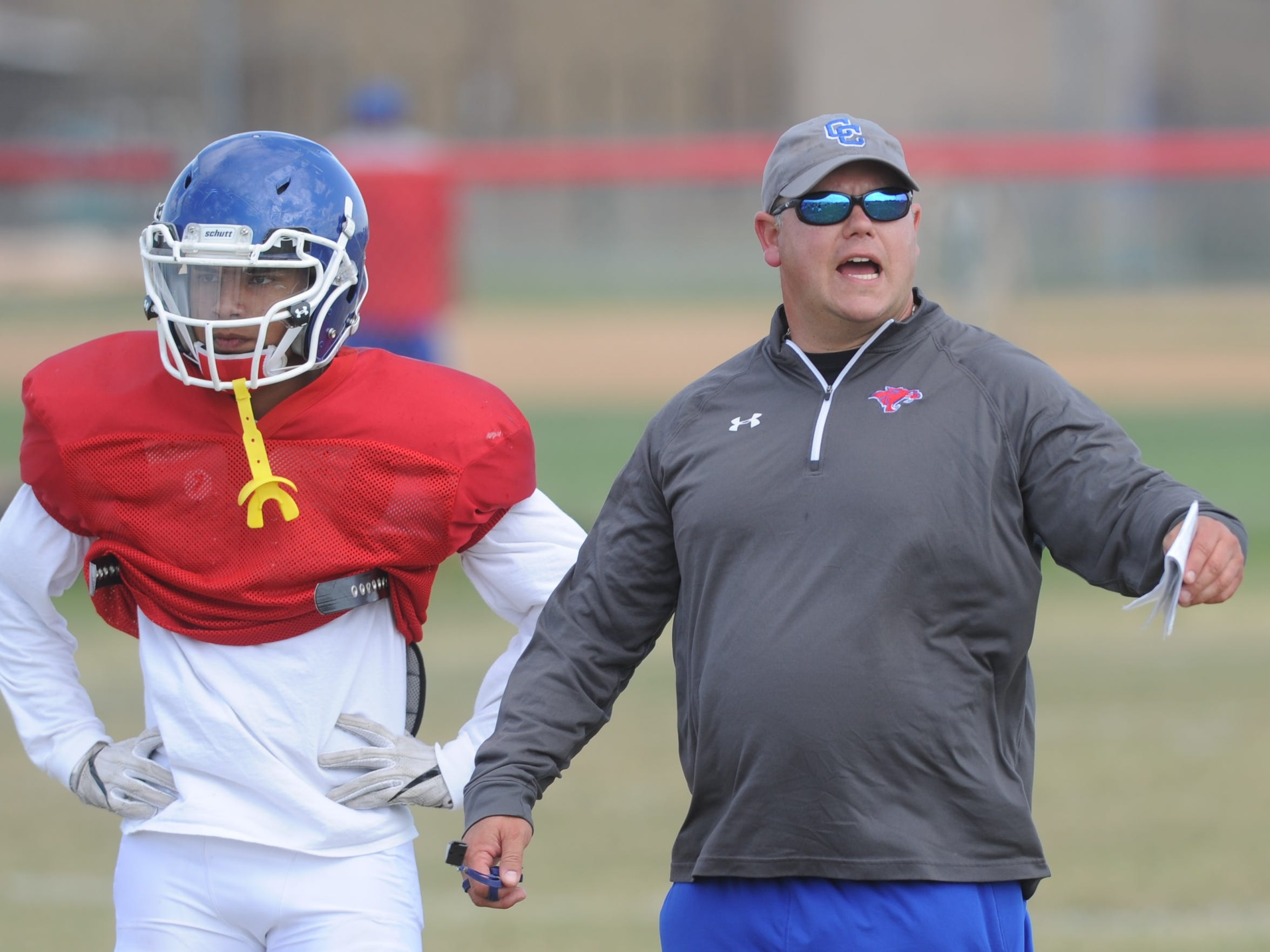 Cooper coach Todd Moebes, right, works with the defense