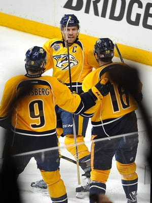 Predators defenseman Shea Weber, center, celebrates his 150th career goal in the second period Tuesday.