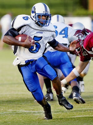 Godby running back Roy Upchurch (5) ran past, through and over the Chiles defense for long gainers and a touchdown in the first half of the high school jamboree at Cox Stadium.